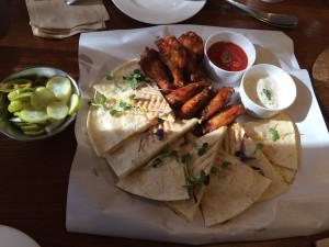 Buffalo wings and chicken quesadillas served with pickles, salsa and sour cream.